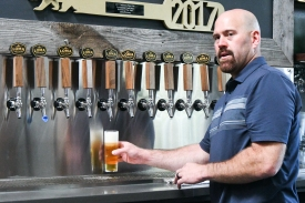 Kevin Youkilis pours himself a taste of the brand-new Inner Hoppiness hoppy pilsner