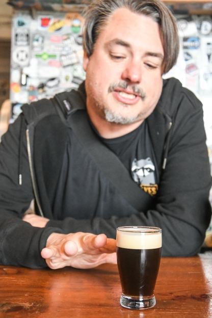 "John Gillooly, brewmaster, talking about his ""current artistic favorite,"" the Electric Owl coffee barrel-aged porter"