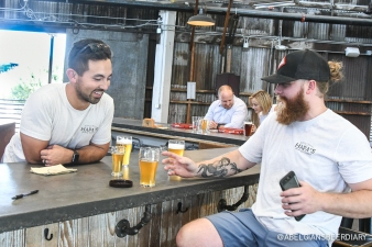 Co-owner Derek Tam and Assistant Brewer Trey Schaaf talk beer at the Hapa's Brewing taproom
