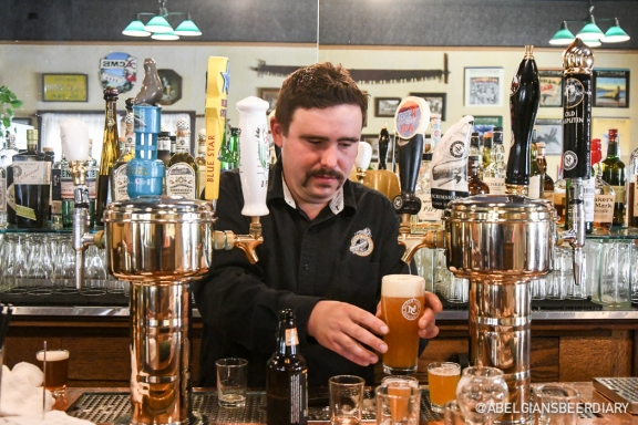 Bartender Will Miller is serving customers in the taproom