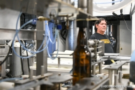 Head Brewer Carlos Sanchez behind the bottling line