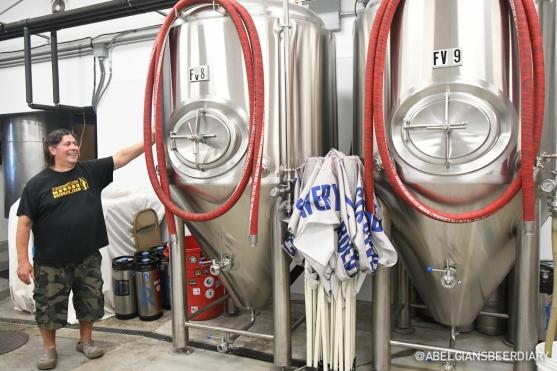 Head Brewer Carlos Sanchez is showing off fermentation tanks